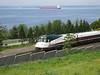 Freighter on Elliott Bay and Amtrak Cascades passenger train, from SAM Sculpture Park