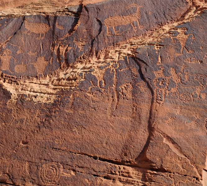 Day 1 - Tuesday, 9/13 - we meet at the Oars warehouse and are shuttled to the put-in at Potash.<br /> The petroglyphs were along the road to Potash