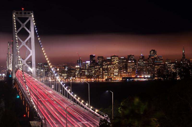 Nighttime Bay Bridge with San Francisco Skyline