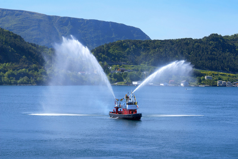 Traditional Norwegian Fire - Boat at Alesund Harbour, Norway