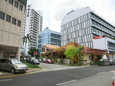 The red building at the corner is a shrine in Jalan Besar.