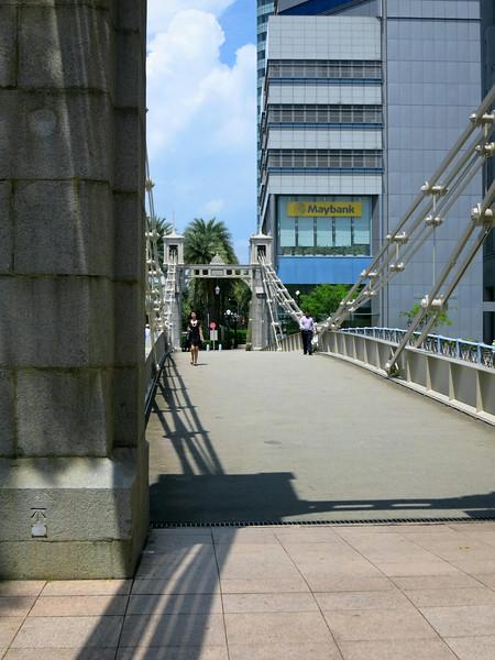 Cavenagh Bridge, 1870, spans the Singapore River at Fullerton Square.