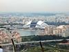 Ferris Wheel, housing, and stadium from Ku dé Ta , Marina Bay Sands.