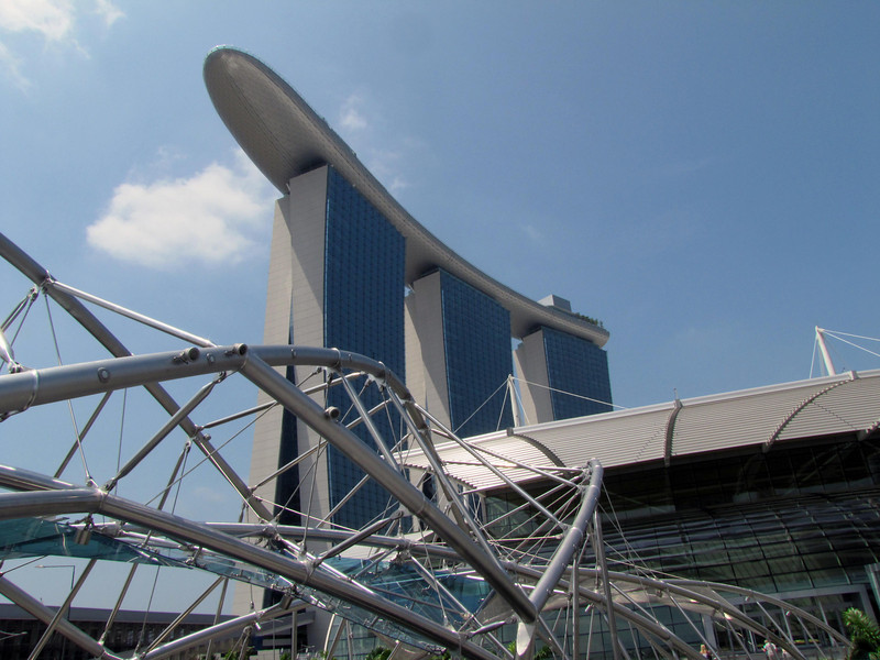 One-year old Marina Bay Sands Hotel, 3 offset towers, 2,500 rooms. The 57th floor SkyPark links the towers.