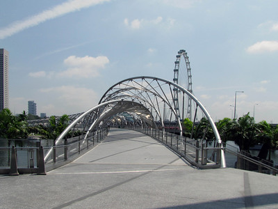 This pedestrian bridge over the edge of The basin connects Marina Bay Sands to a soccer stadium and cinemas.