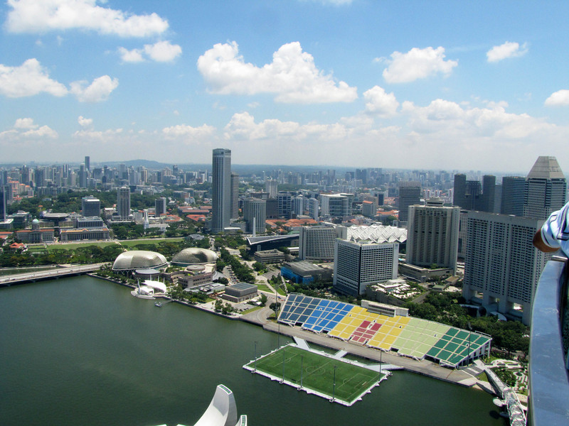 Esplanade (left), theaters on the bay (roundish), Raffles City (tower), soccer field and stands