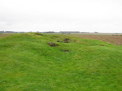 Site of Pozieres Windmill. Thiepval Memorial can be seen in the left background and Mouquet Farm is slightly nearer just to the left of the Windmill mound.