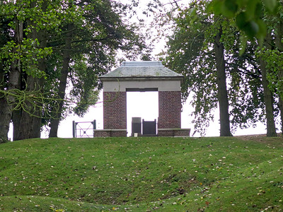 A view looking up through the Park from Railway Hollow with the Sheffield Pals Memorial Gateway in front. A shell hole in the immediate foreground.