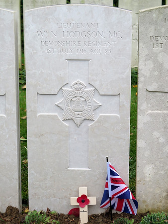 "Headstone of Lt William Noel Hodgson MC, who had written a poem ""Before Action"" the last line of which read 'Help me to die, O Lord'. Which was published just two days before he died.The full poem can be read here,  http://www.greatwar.co.uk/poems/william-noel-hodgson-before-action.htm"