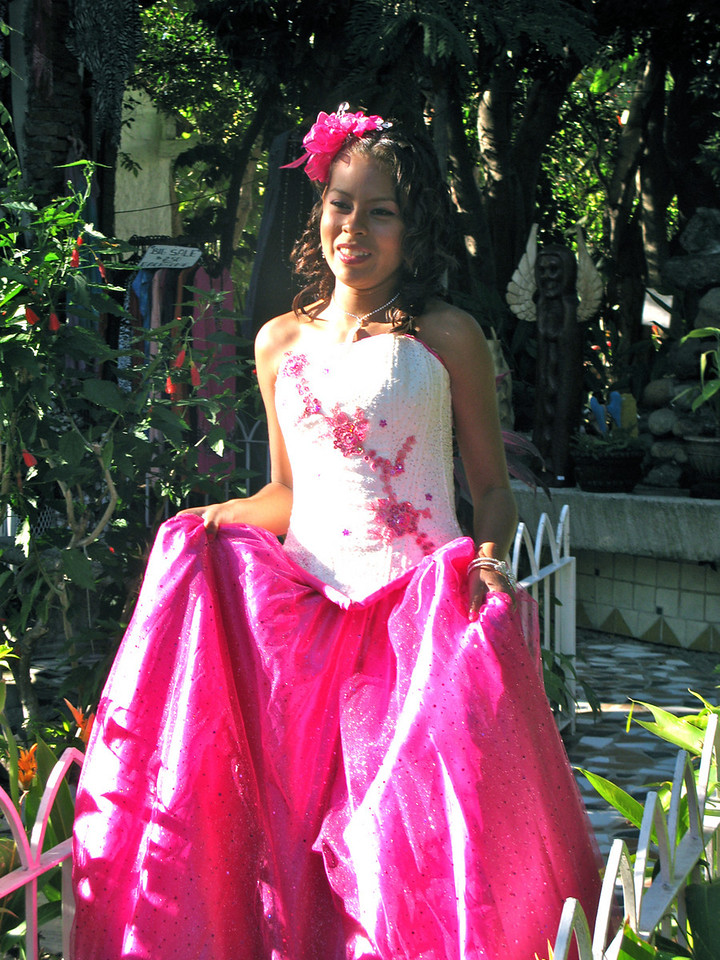 A young girl being photographed for her Quinceanera, or 15th birthday, which is celebrated almost like a bar or bat mitzvah.