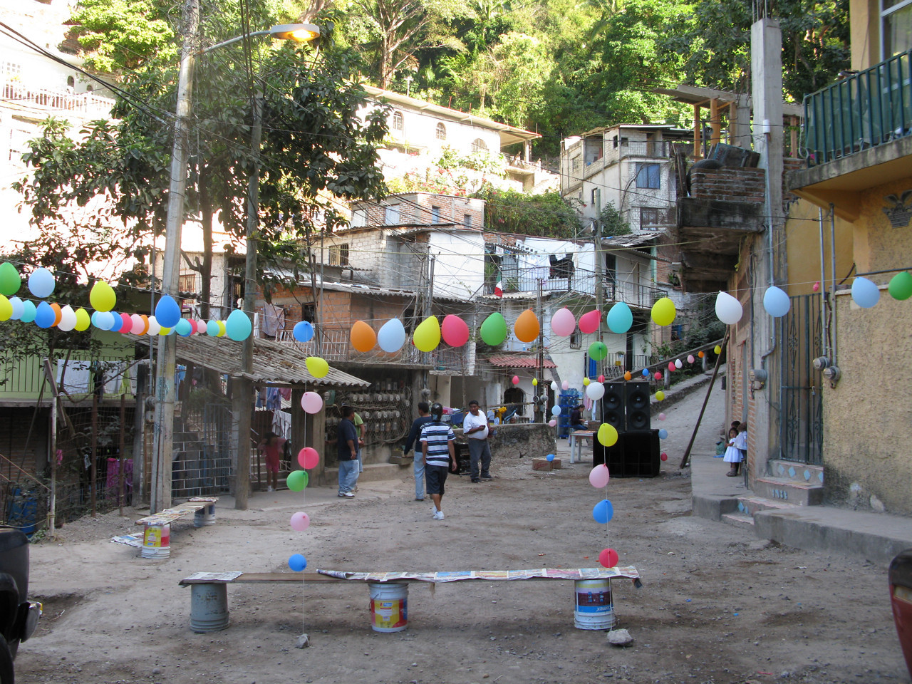 Small neighborhood up the hill from me getting ready for a fiesta.  I walked up here to check out an apartment, and it was so steep I completely vetoed the idea.  The apartment was the one at the top of the photo, about a hundred stone steps up a curved towerlike stairway.
