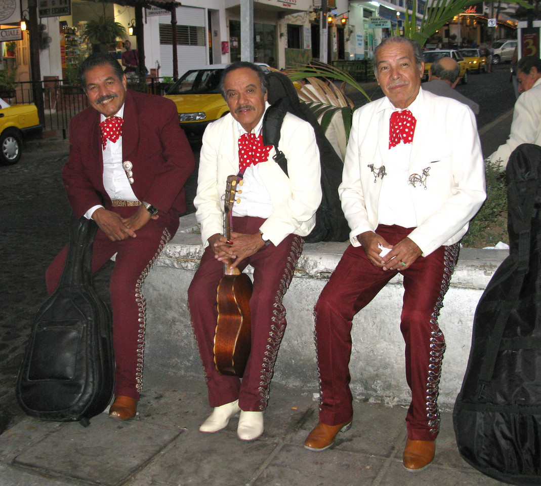 Strolling musicians who wander along the beach or into restaurants waiting to serenade anyone willing to pay.  Cielito Lindo and La Cucuracha are frequent requests.  They are always dressed impeccably.