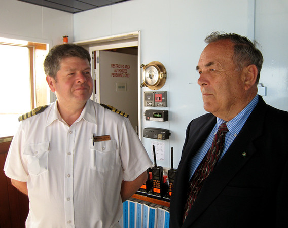 Captain Mark confers with Bill Green, USN Ret.