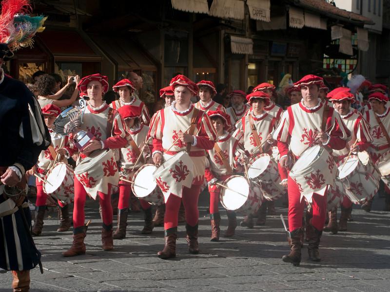 Neighborhood drum corp crosses Ponte Vecchio