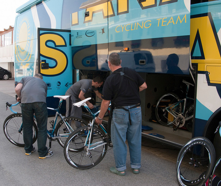 Astana mechanics load bike into team bus