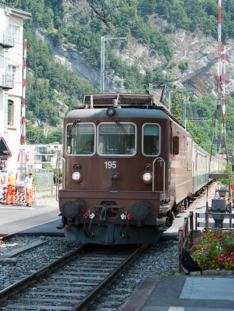 An old, but well-maintained train pulls into Interlaken OST station