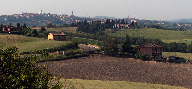 Returning to Siena on the hilltop after a day of riding.  You can see the main city tower and Duomo even from here.