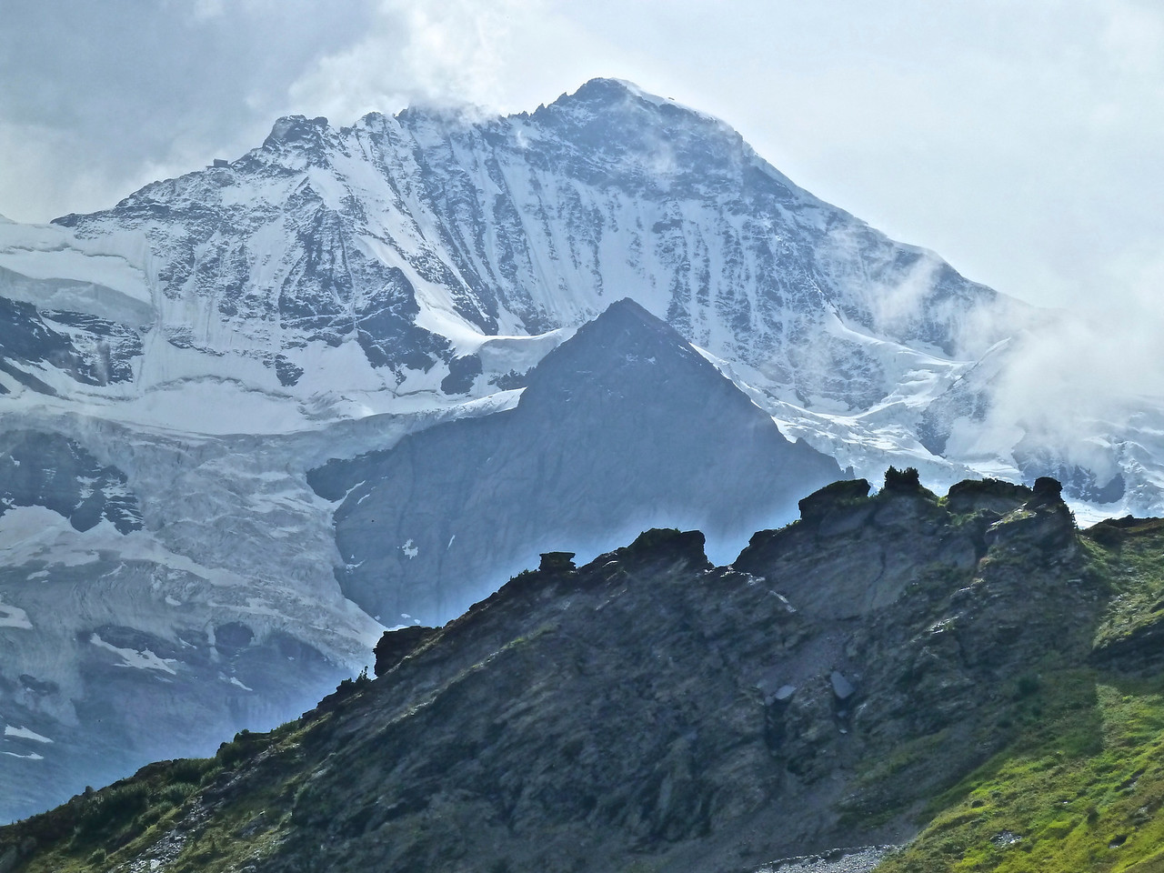 This is the impressive Jungfrau (Virgin) Mountain at 13,642 ft! We waited forever for the clouds to lift to get this shot!!