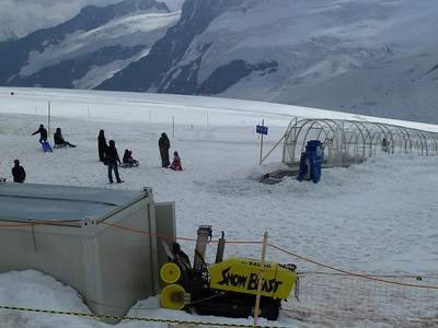 For some visitors, their first encounter wirh snow.  The conveyor belt in the platsic tubes is the lift.