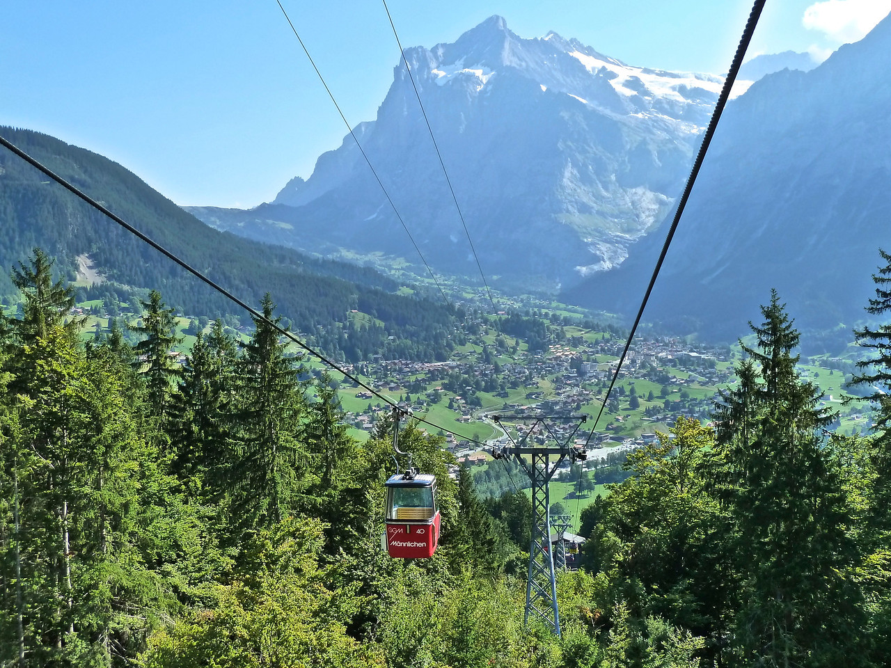 This is the longest gondola ride in Europe - 30 min - with Grindelwald in the valley and the Wetterhorn mountain (12,143 ft) in the back. The house with our apartment is right at the foot of that mountain!