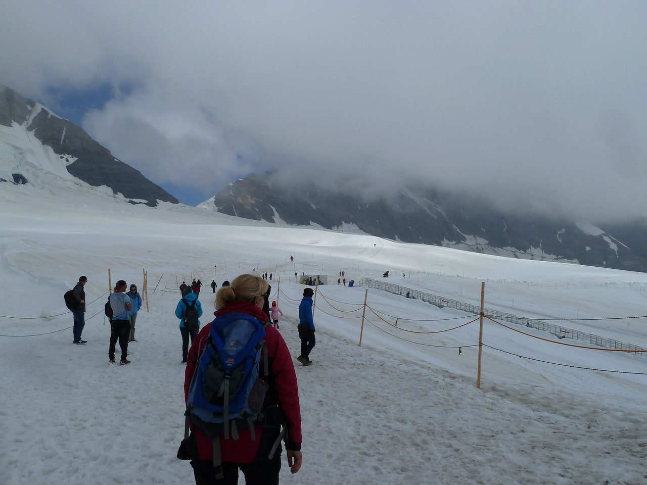 Hiking out over the glacier from the Jungfraujoch to the Mönchsjoch Hut, a climbers' hut at the notch in the distance - about an hour's hike. Again, we are at about 3400 m going to 3600 m (11,300 ft to 11,800 ft). And yes, one certainly noticed the altitude!!