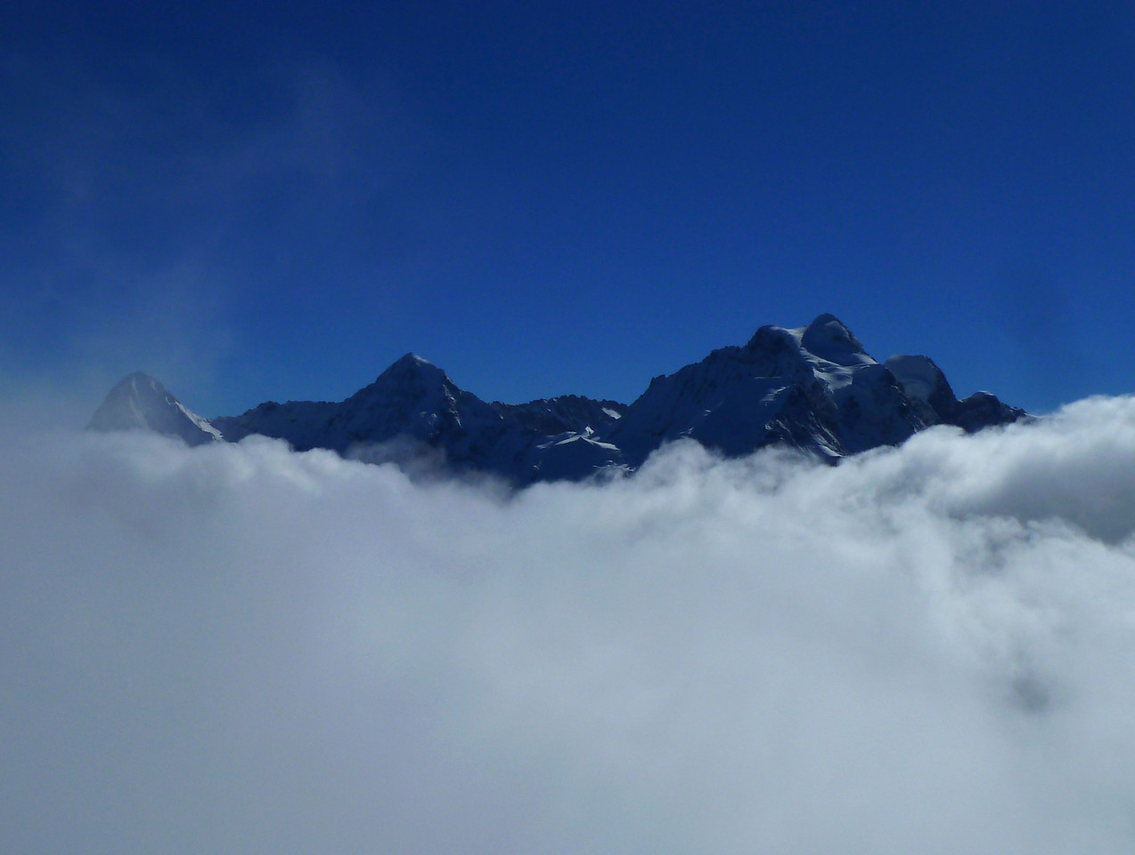 The classic trio - Eiger, Mönch and Jungfrau - as seen from the Schilthorn above the clouds.