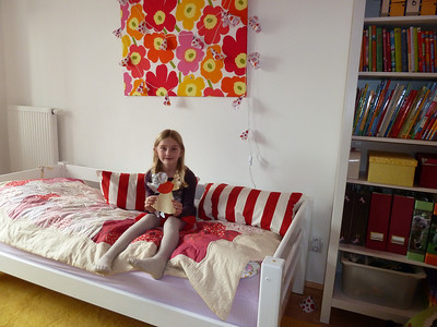 Lina in her recently renovated room with her art work.