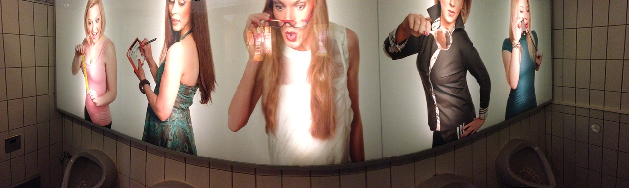 Interesting mural above the urinals in a men's room in a Munich restaurant.