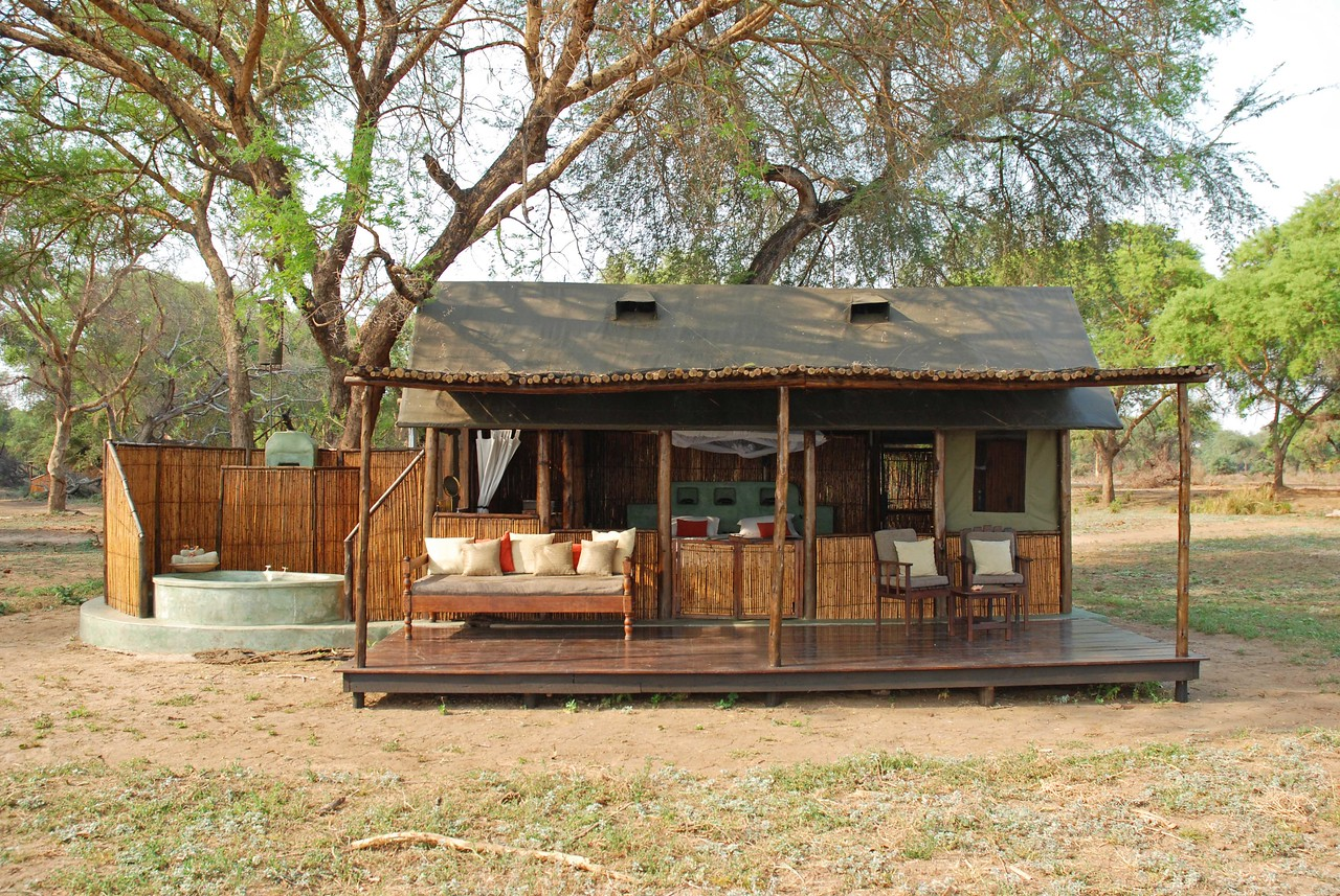 Our tent at Old Mondoro - our favourite tented camp<br /> <br /> Old Mondoro Bush Camp in Lower Zambezi National Park - our favourite tented camp of the trip. A stunning location overlooking the Zambezi River, an intimate atmosphere with only four tents/eight guests, luxurious and very comfortable tents, excellent food, delightful hosts in Jason and Michaela who made us feel immediately welcome, expert guiding by Levy, Sebastian and Morat, outstanding game viewing including 7 leopards on three night drives, a lioness and two cubs on a kudu kill, five honey badgers, several porcupines, so many civets and large spotted genets that we lost count, and many lovely birds - a very special camp.