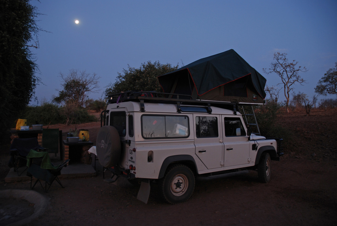 "The Land Rover and the roof-top tent under a full moon at Ihaha campsite in Chobe National Park<br /> <br /> The 2011 Land Rover Puma TDCI, which was named ""Ranulph"" after British adventurer Ranulph Fiennes. The vehicle had only 15,729km on it when we received it. It was our home for six weeks, and was fully equipped with everything we needed. It took us safely through Namibia, Botswana and Zambia, including along a route near Lower Zambezi National Park in Zambia that was listed as ""not recommended"" on Tracks4Africa. <br />  <br /> We loved the roof top tent, which was very comfortable and cosy, and protected us from torrential rains, gale force winds, and the many elephants, hippos and predators that wandered through our campsites during the night. It came with sheets, a duvet, four pillows and extra blankets - no roughing it here!"