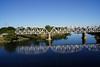 View of rail bridge from foot bridge across Sacramento river.