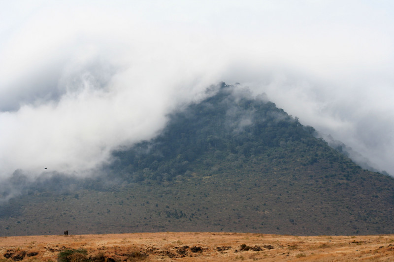 Mountains surrounding the crater covered with clouds.