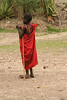 Masai boy draped in the traditional red clothes and the.