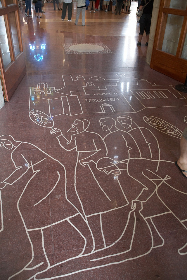 These figures are on the floor just inside the Passion Facade entrance.