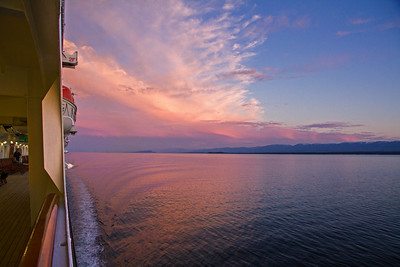 Looking to ship's stern and evening glow in sky
