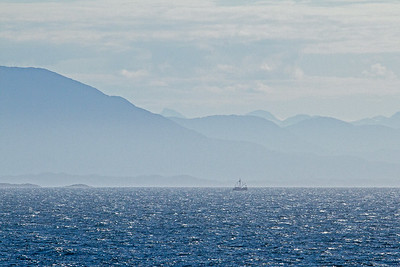 A fishing boat in the distance