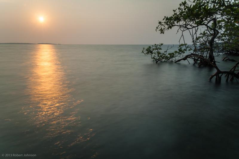 Equinox sunrise Pelican Cayes