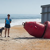 Vilano beach, dog, buoy and guirl