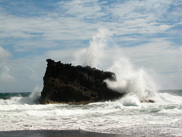 Surf pounding on a large rock along the coastline of St. Vincent in the Caribbean. © Rob Huntley