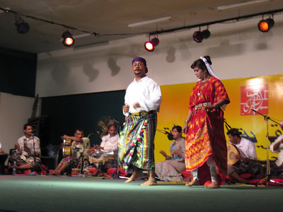 """Omani dancers and musicians.  Omani music is quite different t standard """"Arabic"""" music having distinct Indian and Afican influences and with a lot of use of """"call and response"""".."""