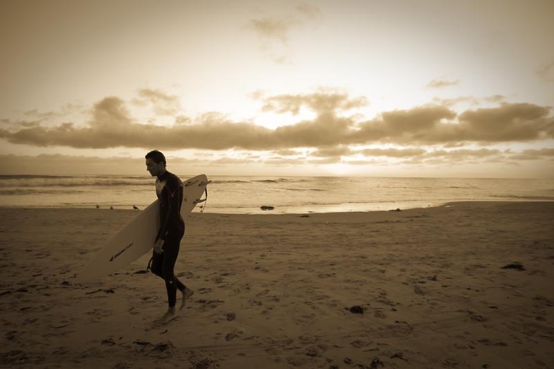 Surfer walks away from Salt Creek Beach