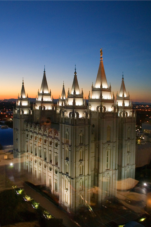 View of the Salt Lake temple from the Roof restaurant on top of the Joseph Smith Memorial Building.  You can see reflections of the restaurant interior in the bottom half of the photo.
