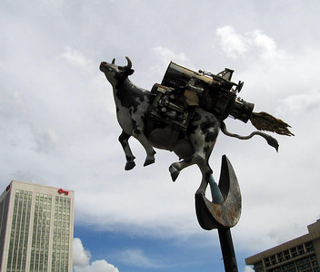 "Another one of the ""flying"" themed street sculptures, this one with a rocket-propelled cow. Salt Lake City, UT. 8 Apr 2007."