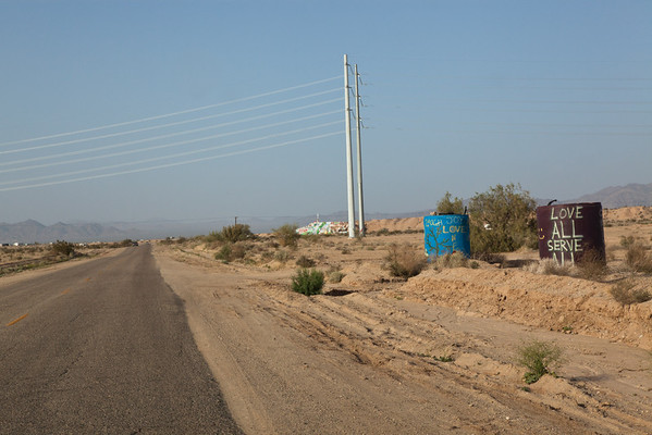 That's Salvation Mountain in the distance on the right side of the road.
