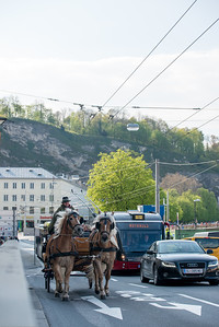 Tourists love to take the old fashioned horse carriage to tour the central areas of Salzburg, Austria.