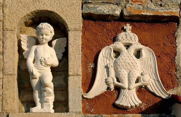 Cherub and Greek Orthdox Church symbol, Agia Varvara (Saint Barbara) Monastery, Kamara, Samos, Greece, 25 December 2008