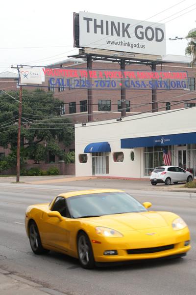 Sports car and a billboard.