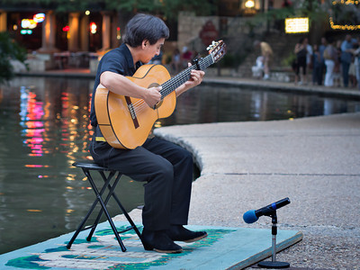 Flamenco guitarist on riverwalk
