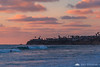 Pink sunset skies over San Diego beach