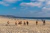 Playing ball on San Diego beach